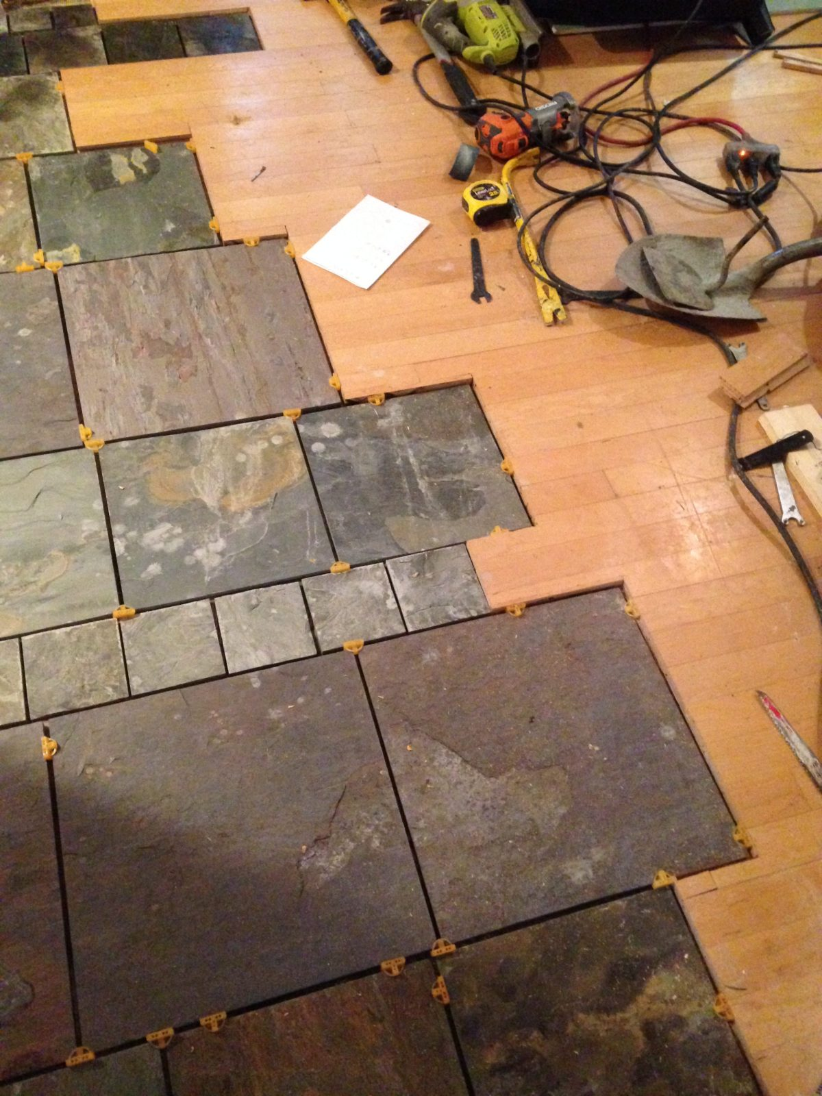 artist brandon roth mates custom slate flooring with existing wood flooring