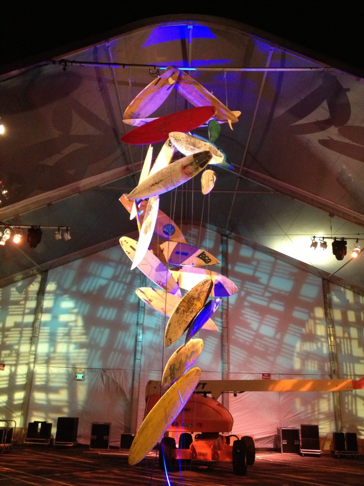 artist brandon roth builds a chandelier made of surfboards with ZOe Productions for corporate client