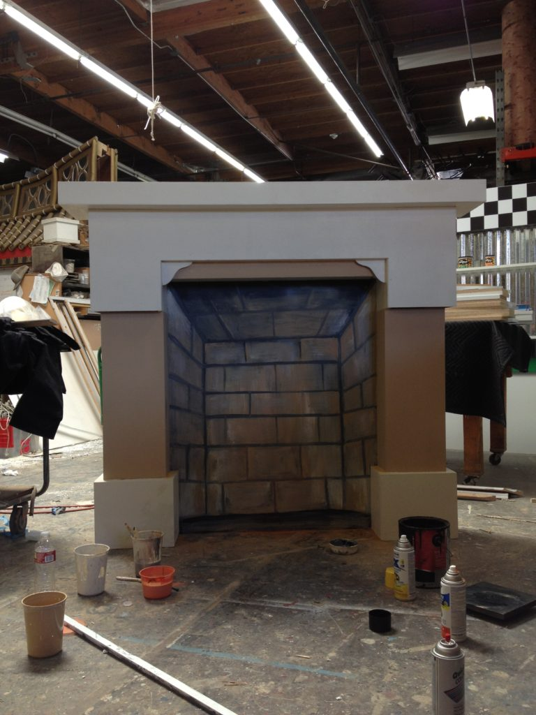 Artist brandon roth builds a scenic prop for theater
