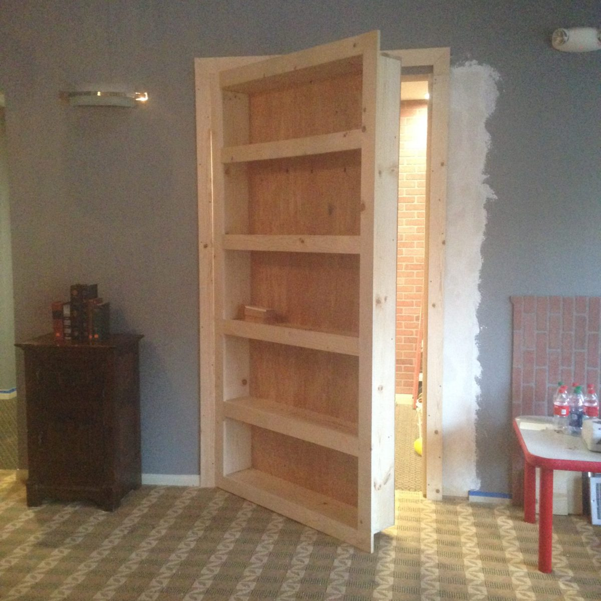 artist brandon roth builds a hidden room behind a bookcase